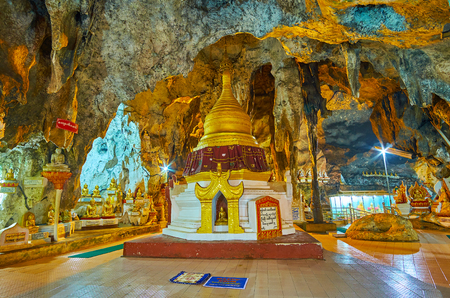 PINDAYA, MYANMAR - FEBRUARY 19, 2018:  The stupa with Buddha image is located in lower cave of Pindaya and surrounded by unique rock formations, named Resonant stalactite Editorial