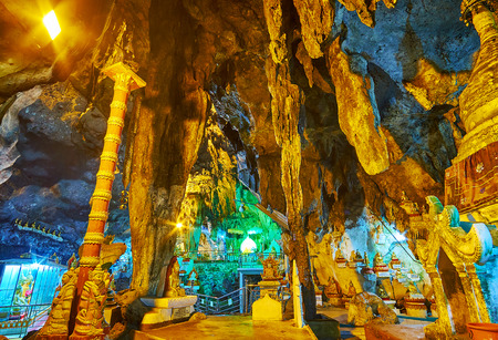 PINDAYA, MYANMAR - FEBRUARY 19, 2018:  The scenic Buddhist column in stalactite cave of Pindaya cave Stock Photo - 121602071