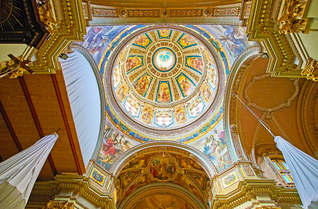 FLORIANA, MALTA - JUNE 19, 2018: The dome of St Publius Parish Church with many beautiful frescoes, separated by carved gilded garlands, on June 19 in Floriana.