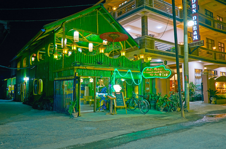 NYAUNGSHWE, MYANMAR - FEBRUARY 19, 2018: The scenic bamboo building of restaurant attracts the tourists to spend evening here, on February 19 in Nyaungshwe. Фото со стока - 122640010