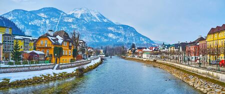The Mount Katrin dominates the skyline of Bad Ischl, its snowy peak and white line of cable car are seen from the bridges over the Traun river, Salzkammergut, Austria.