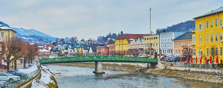 Walk along the riverside quarters of Bad Ischl and enjoy its historical housing, Traun river and bright green Elizabethbrucke bridge, Salzkammergut, Austria Reklamní fotografie