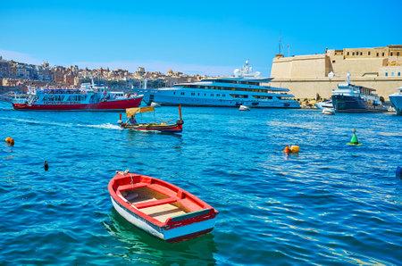 SENGLEA, MALTA - JUNE 19, 2018: The pleasure boat makes a trip along the Gand Harbour of Valletta, floating at Fort Saint Angelo of Birgu, on June 19 in Senglea. Editorial