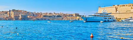Panorama of Valletta Grand Harbour with medieval fortifications of Valletta and Fort Saint Angelo of Birgu, Malta.