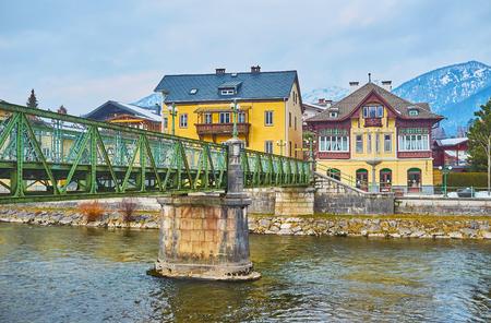 The Taubersteg pedestrian bridge connects the banks of Traun river with old scenic villas, Bad Ischl, Salzkammergut, Austria.