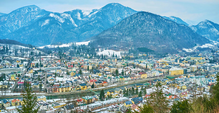 The aerial cityscape of Bad Ischl and huge Alpine mountain range on the background, Salzkammergut, Austria