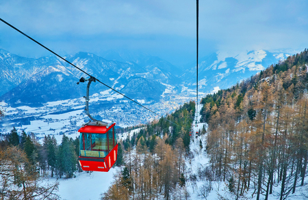 The long route of Mount Katrin cable car stretches along the snowy mountain slopes , Bad Ischl, Salzkammergut, Austria