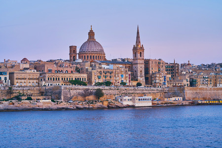 Enjoy the beauty of medieval Valletta with its massive fortress wall, great Carmelite church, St Paul Pro-Cathedral and residential edifices on blue hour, Malta