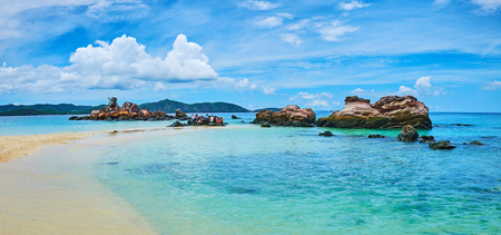 Explore the nature of Khai Nai island, walking along the sand spit and observing huge rocks and boulders, Phuket, Thailand