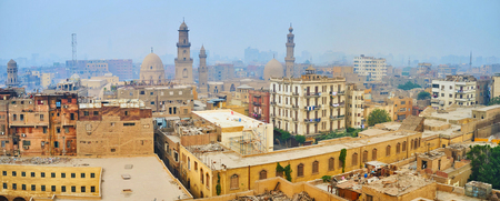 Enjoy the cool winter morning in Islamic Cairo, its shabby residential buildings and medieval mosques are covered with blue fog, Egypt Stock fotó