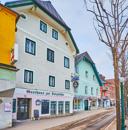 BAD ISCHL, AUSTRIA - FEBRUARY 20, 2019: The Esplanade embankment is nice place for shopping or visiting traditional Austrian restaurant, on February 20 in Bad Ischl 에디토리얼