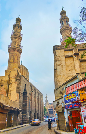 CAIRO, EGYPT - DECEMBER 22, 2017: The minarets of historic complex of Mosque and Khanqah of Shaykhu, located in Al-Saleeba street, on December 22 in Cairo, Egypt.