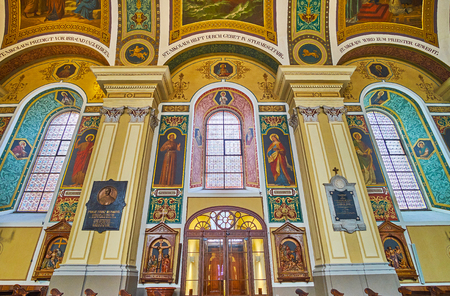 BAD ISCHL, AUSTRIA - FEBRUARY 20, 2019: The wall of St Nicholas Parish Church is decorated with stained-glass windows, columns and colorful frescoes, on February 20 in Bad Ischl