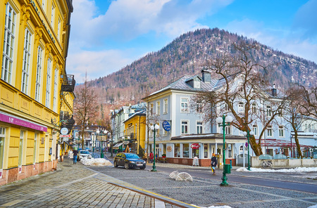 BAD ISCHL, AUSTRIA - FEBRUARY 20, 2019: The high mountain behind historic building of Cafe Ramsauer, located in Kaiser-Franz-Josef-Strasse street, on February 20 in Bad Ischl