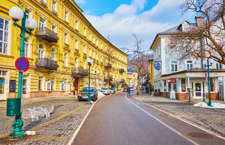 BAD ISCHL, AUSTRIA - FEBRUARY 20, 2019: The old town streets boasts vintage streetlights and many preserved historical edifices, coffee houses and stores, on February 20 in Bad Ischl