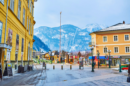 BAD ISCHL, AUSTRIA - FEBRUARY 20, 2019: Architecture of the scenic Alpine town with colorful buildings, tall weathervane and Katrin Mount on the background, on February 20 in Bad Ischl Editorial