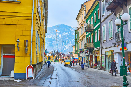 BAD ISCHL, AUSTRIA - FEBRUARY 20, 2019: Pfarrgasse shppping street is one of the main tourist locations with many brand stores, cafes, bars and souvenir shops, on February 20 in Bad Ischl