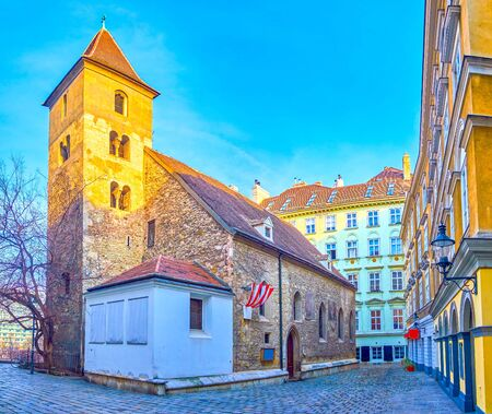 The old stone medieval St Rupert's Church with bell tower and authentic small entrance doorframe on the side wall, Vienna, Austria