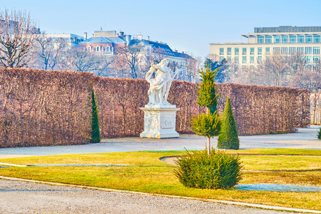 VIENNA, AUSTRIA - FEBRUARY 18, 2019: The large amount of carved sculptures of Greek mythology characters are perfectly complement beautiful French styled park, on February 18 in Vienna Editorial
