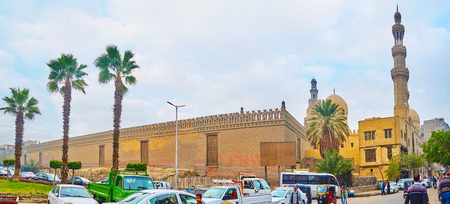CAIRO, EGYPT - DECEMBER 22, 2017: Panorama of Al Khoderi street with a view on the fortress wall of Ibn Tulun mosque and the tall minaret of Amir Sarghatmish mosque, on December 22 in Cairo, Egypt.