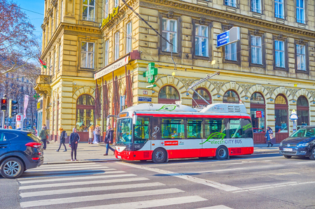 VIENNA, AUSTRIA - FEBRUARY 18, 2019: The small modern electric bus with folding poles is the ideal choice for tight streets in historical center, on February 18 in Vienna.