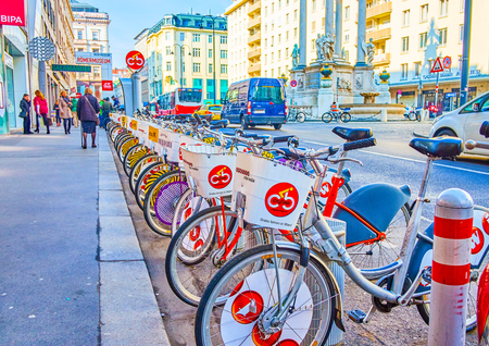 VIENNA, AUSTRIA - FEBRUARY 18, 2019: The line of municipal bicycles for hire, parked at the special place in Hoher Markt (High Market), on February 18 in Vienna.