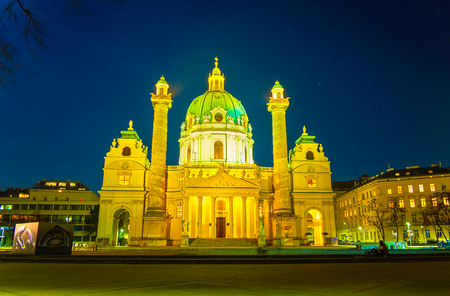 VIENNA, AUSTRIA - FEBRUARY 18, 2019: The bright illuminated Karlskirche (Charles Church), that is one of the most unufual churches in city with two carved columns, on February 18 in Vienna. Editorial