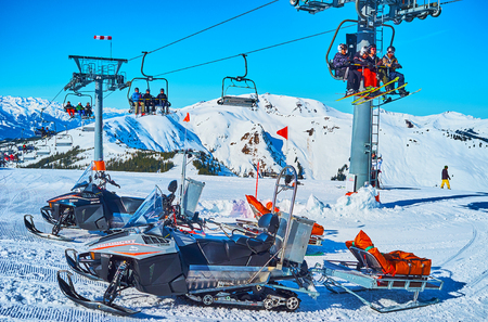 ZELL AM SEE, AUSTRIA - FEBRUARY 28, 2019: The modern rescue sleds with safety equipment are parked at Kapellenbahn chairlift, riding along the slope of Schmittenhohe mount, on February 28 in Zell Am See. Editoriali