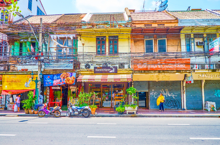 BANGKOK, THAILAND - APRIL 22, 2019: The old houses in Banglampu district with tourist cafes on the ground floor, on April 22 in Bangkok Editorial