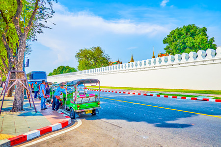 BANGKOK, THAILAND - APRIL 22, 2019: The surrounding area of Grand Palace is the most beloved place for finding clients among tuk-tuk taxi drivers, on April 22 in Bangkok 에디토리얼