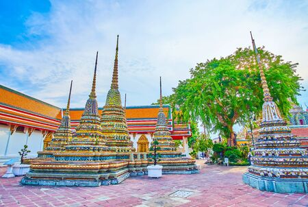 The decoration of shrines and chedis (stupas) of Wat Pho temple is a fine example of unique Thai religion architecture, Bangkok, Thailand