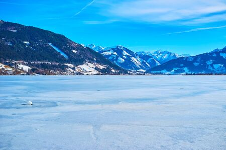 Walk  Elisabeth park and watch the frozen Zeller see lake, located in Alpine mountain valley, Zell am See, Austria