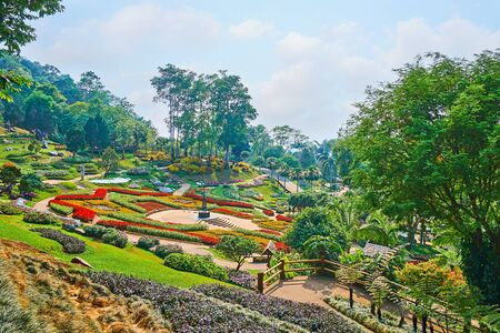 Enjoy the day walk in pleasant Mae Fah Luang garden with scenic flower beds, shady trees and topiary shrubs, Doi Tung, Thailand