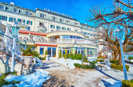 ZELL AM SEE, AUSTRIA - FEBRUARY 28, 2019: The fashionable Grand Hotel, lcated on the bank of Zeller See lake, is one of the most popular hotels in city, on February 28 in Zell Am See Editorial