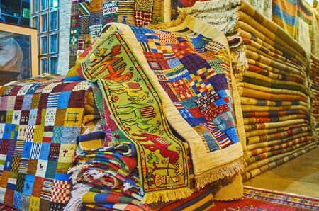 The rug store in Vakil Bazaar offers tradtional woolen carpets with colorful patterns, Shiraz, Iran