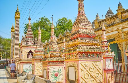 Extraordinary architectural design of Thanboddhay Pagoda with many funerary stupas, covered with fine stucco patterns in pastel colors, Monywa, Myanmar