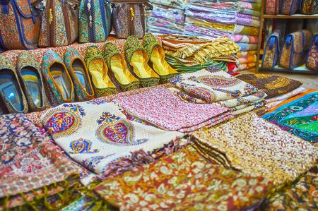The wide range of traditional textile bags, slippers and scarfs, decorated with colorful prints, embroidery, and lurex, Vakil Bazaar, Shiraz, Iran Zdjęcie Seryjne - 127427865