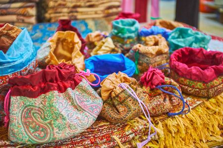The colorful gift bags, made of termeh - luxury handmade brocade of wool and silk, decorated with Persian patterns, Vakil Bazaar, Shiraz, Iran