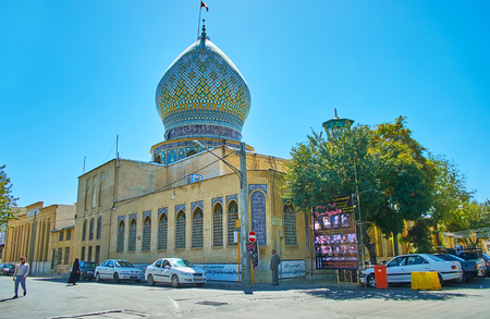 SHIRAZ, IRAN - OCTOBER 14, 2017: The brick building of Ali Ibn Hamzeh Holy Shrine with ornate tile decorations, traditional for Persian cult architecture, on October 14 in Shiraz