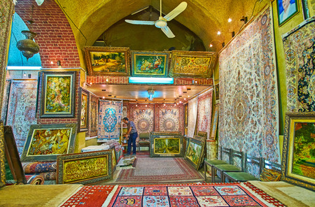 SHIRAZ, IRAN - OCTOBER 14, 2017: Walk the carpet section of Vakil Bazaar and enjoy traditional Persian carpets, woolen rugs, tapestries, Eastern kilims and other handmade souvenirs, on October 14 in Shiraz. Editorial