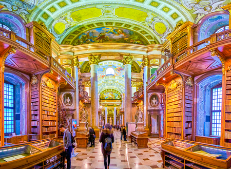 VIENNA, AUSTRIA - MARCH 2, 2019: The corridor of National Library with vintage bookshelves and frescoes on the ceiling, on March 2 in Vienna