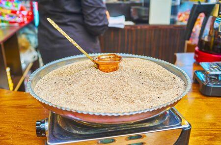 Tajrish Bazaar's coffee house with copper cezve, boiling in the hot sand, Tehran, Iran