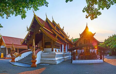 Panorama of Wat Samphao (Saumpow, Sam Pao) Temple, its scenic viharn is decorated with statues of Makara crocodiles, spewing Naga serpents from their mouths, Chiang Mai, Thailand