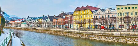 BAD ISCHL, AUSTRIA - FEBRUARY 20, 2019: Enjoy the cityscape of old town from the bank of Traun river, overlooking historic mansions, riverside park and tourist cafes, on February 20 in Bad Ischl.