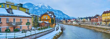 BAD ISCHL, AUSTRIA - FEBRUARY 20, 2019: Panorama of the banks of Traun river with old town quarters, historic housing and foggy Katrin Mount on the background, on February 20 in Bad Ischl