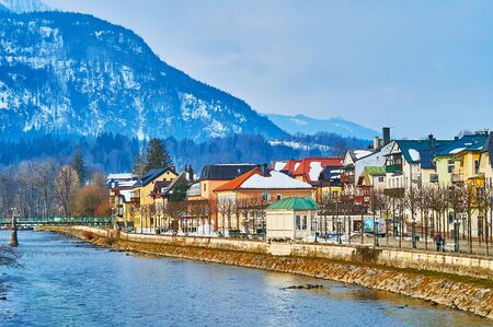 BAD ISCHL, AUSTRIA - FEBRUARY 20, 2019: Esplanade embankment of Traun river with a view on historic quarters, colorful townhouses, souvenir stores and restaurants, on February 20 in Bad Ischl. Editorial