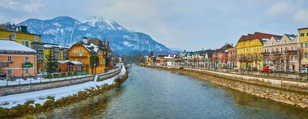 BAD ISCHL, AUSTRIA - FEBRUARY 20, 2019: Enjoy the riverside panorama with historic edifices along the banks and snowy Mount Katrin, dominating the town, on February 20 in Bad Ischl.