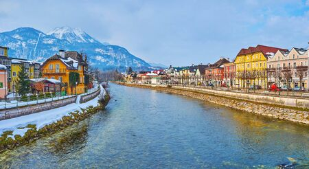 BAD ISCHL, AUSTRIA - FEBRUARY 20, 2019: Observe the city on banks of Traun river with snowy Mount Katrin on background, on February 20 in Bad Ischl.