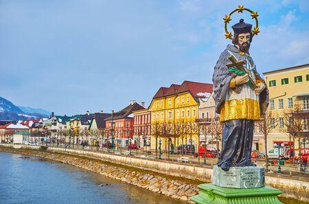 BAD ISCHL, AUSTRIA - FEBRUARY 20, 2019: The sculpture of St Johannes Nepomuk decorates Elizabethbrucke (bridge) over the Traun river, on February 20 in Bad Ischl.