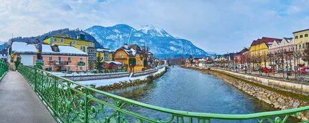 BAD ISCHL, AUSTRIA - FEBRUARY 20, 2019: Panorama of the old town from the Elizabeth bridge with a view on housing, Katrin mount and Traun river, on February 20 in Bad Ischl.